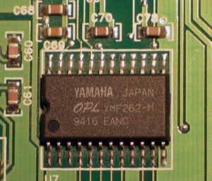 Photograph of the YMF262-M audio processor widely used in sound cards of the 1990's